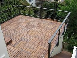 terrace tile wood deck over roof railing on the face of wall and not penetrating roof membrane