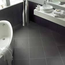 ceramic tile for bathroom floors: black tile bathroom round sink under modern faucet closed amusing mirror in contemporary bathroom with simple