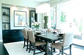 chandelier over dining table rectangle dining room chandelier over wooden dining table and beige fabric covered