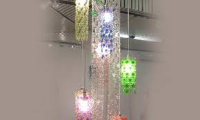 dazzling cascade chandelier is made from chains of recycled plastic bottle flowers