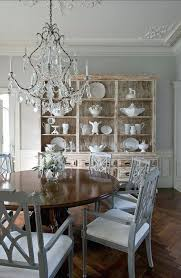 chandelier over kitchen table living room hutch dining room traditional with crystal chandelier dark wood image