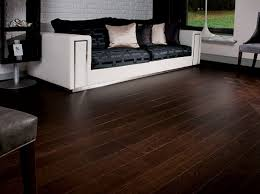 wood floor designs. Dark Wood Floor Living Room With White Sofa And Painted Brick Wall Designs