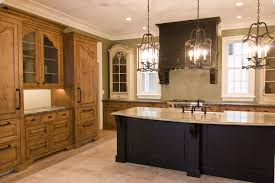tuscan kitchen lighting. immense black wood island with light marble countertop dominates this kitchen featuring an open space tuscan lighting s