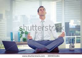 meditation businessman office. zen businessman doing yoga meditation on the desk office