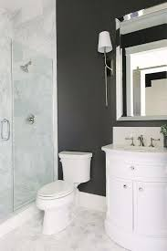 black powder room wall with half moon bath vanity