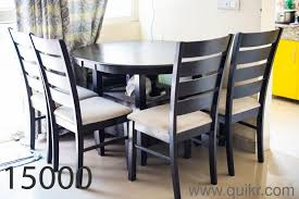 gently used four seater dining table