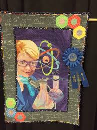 Innocent Until Proven Quilty: Greater San Antonio Quilt show & This quilt was made from a selfie my daughter, Nicole, took right before  she got her degree in Chemistry last spring. So proud of her. Adamdwight.com