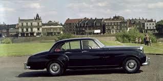 a black s1 continental on a 50s british city road bentley motors