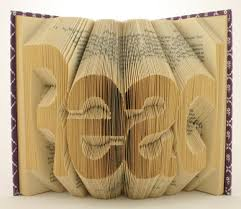 new mexico book artist isaac g salazar folding the pages of books to create new words out of old books