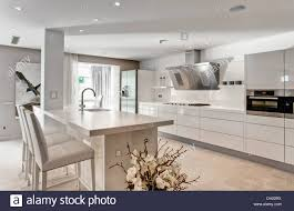 Bar In Kitchen White Stools At Breakfast Bar In Large White Kitchen In Newly