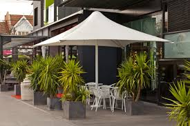 large commercial wind rated permanent umbrellas skyspan melbourne