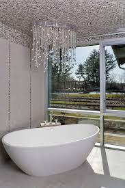 ikea crystal chandelier bathroom contemporary with mosaic tile tile stripe bathroom lighting