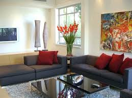 enchanting living room design with dark gray sofa and red cushions for home decor inexpensive traditional grey couch