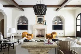 living room furniture ideas mediterranean style black chandelier stone table built in tv stand cabinets shelves