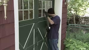 stock of burglar checks through garage window then 3704219 shutterstock