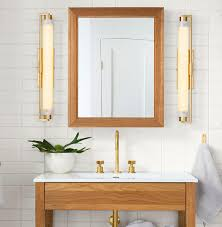 damp rated lights are ideal above sinks or as the main overhead light in a full bath whereas a wet rated fixture is needed for lights above a bathtub or