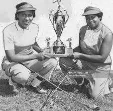 Two women, Sarah Smith and Ethel Finch, posing with a large trophy ...