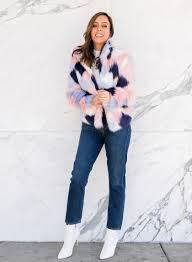 sydne style wears colorblock faux fur coat jeans and white booties