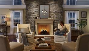cozy neutral living room stone accent wall stone fireplace seaside cottage
