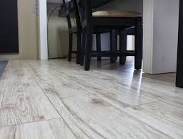 white laminate wood flooring installed in a kitchen