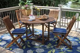eucalyptus round fold dining set with blue cushions 2