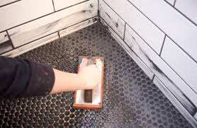 i ve always had a soft spot in my heart for small mosaics in a shower so i went with matte black penny tile for the floor and the back of the soap niches