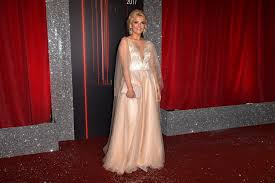 Kym Marsh brings Hollywood glamour to Soap Awards with winning red.