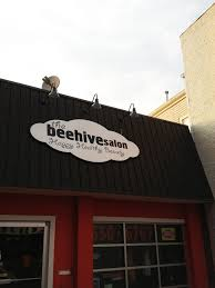 our gooseneck sign lights mounted outside the beehive salon light fixture 20 850