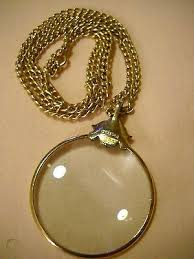 vintage avon magnifying glass necklace