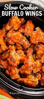 slow cooker buffalo wings piled inside the slow cooker