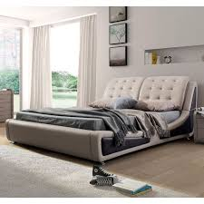 Update your bedroom with this contemporary bed. The unique, gently curved  rails are upholstered