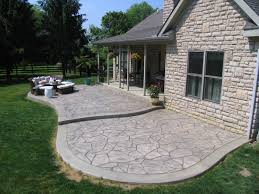 using backyard stamped concrete patio ideas