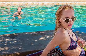 Blonde lesbians indoor pool