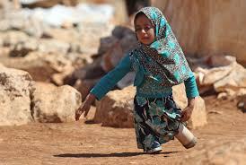 8-year-old Syrian girl uses tin cans as legs - CGTN