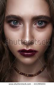 biker or rocker beauty with dark red makeup