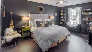 Eclectic master bedroom with black walls