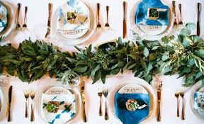 place eucalyptus or another favorite green down the center of your tables this earthy yet classic centerpiece will bring extra life to your wedding