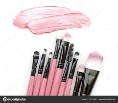 pink color skin foundation beige cream paint stroke and brushes make up on background stock