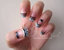 Negative space black and white funky french tips in Aztec / tribal ...