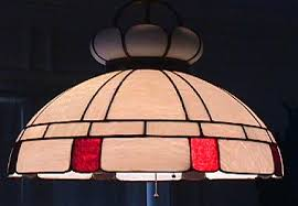 this is an original stained glass chandelier it has only a few very minor ed pieces no chips missing