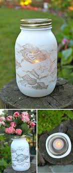Spray paint over lace DIY mason jar vase. I don't know about the lace, but  I like the mason jar idea!