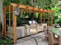 appealing outdoor kitchen ideas with stainless furniture and cream colored dining table also wooden roof with lantern
