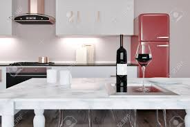 White Marble Kitchen Island With A Bottle Of Wine Standing On
