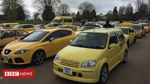 <b>Yellow car</b> owners join rally in support of 'ugly' car - BBC News