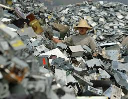 the technological citizen ethics and electronic waste part  ewaste worker on a mountain of e waste