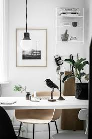 home office style. chic office space in a small home featuring molded desk chair framed photography and suspended pendant light style