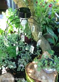diy outdoor chandelier with solar lights solar light chandelier hanging over rustic tree stump table and