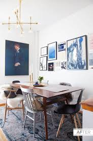 a stunning dining room with great art and mix matched chairs