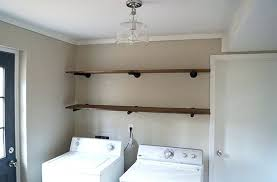 shelving ideas for laundry room completed pipe shelving in a laundry room shelving ideas laundry room