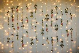 adding flowers to the fairy light wall